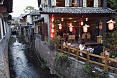Traditional architecture of riverside restaurant in Lijiang Old Town, Lijiang, UNESCO World Heritage Site, Yunnan Province, China, Asia