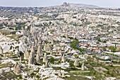 Aerial of the town of Goreme with the Rock Castle of Uchisar on the horizon,  Cappadocia,  Anatolia,  Turkey,  Asia Minor,  Eurasia