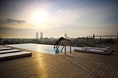 Man diving into rooftop pool,  Barcelona,  Catalonia,  Spain,  Europe