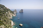 The coast line of the island of Capri, with the famous Faraglioni rocks on the back ground, Capri, Bay of Naples, Italy, Europe