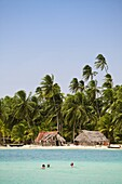 Tourists snorkelling in front of Devil Island, Comarca de Kuna Yala, San Blas Islands, Panama, Central America