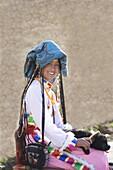 Woman of Naxi minority people, on Tibetan Border, Shangri-La region, formerly called Zhongdian, Yunnan Province, China, Asia