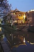 Teahouse at dusk along canal, Suzhou, Jiangsu, China, Asia