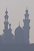 The minarets of the mosques of the old city in the smog, Cairo, Egypt, North Africa, Africa