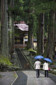 Visitors at Chokushimon Imperial Gate at Eiheiji Temple, headquarters of the Soto sect of Zen Buddhism, in Fukui, Japan