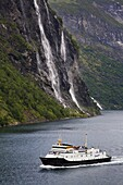 Ferry and waterfall, Geirangerfjord, Northern Fjord Region, Norway, Scandinavia, Europe