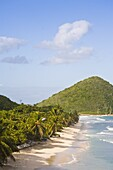 Two women walking on the sandy beach on Long Bay, Tortola, British Virgin Islands, West Indies, Central America