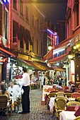Outdoor dining in narrow street of restaurants, Brussels, Belgium, Europe