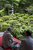 Visitors relaxing at a Zen meditation garden at Sanzenin Temple in Ohara, Kyoto, Japan, Asia