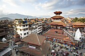 View over Durbar Square from rooftop cafe showing temples and busy streets, Kathmandu, Nepal, Asia
