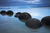 The unusual circular Moeraki boulders along the Otago Coast, Otago, South Island, New Zealand, Pacific