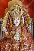 Statue of the Hindu goddess Annapurna (Parvati) giving food, Lakshman temple, Rishikesh, Uttarakhand, India, Asia