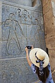Tourist taking a photograph, Temple of Luxor, Thebes, UNESCO World Heritage Site, Egypt, North Africa, Africa
