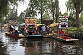 Brightly painted boats, Xochimilco, Trajinera, Floating Gardens, Canals, UNESCO World Heritage Site, Mexico City, Mexico, North America