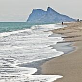 Tourist walking toward Gibraltar, Alcaidesa beach, near Sotogrande, Andalucia, Spain, Europe