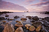 The Brisons on the horizon from the shores of Priests Cove, Cape Cornwall, Cornwall, England, United Kingdom, Europe