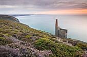 Sunset behind Towanroath Engine House, part of Wheal Coates Tin Mine, UNESCO World Heritage Site, on the Cornish coast near St. Agnes, Cornwall, England, United Kingdom, Europe