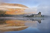A misty autumn morning beside Loch Awe with views to Kilchurn Castle, Argyll and Bute, Scotland, United Kingdom, Europe