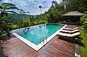 Swimming pool area at luxury accommodation near Ubud, Bali, Indonesia, Southeast Asia, Asia