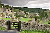 Graveyard and cottages in the pretty Cotswolds village of Snowshill, Worcestershire, England, United Kingdom, Europe