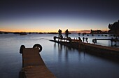 People standing on pier at sunset, Copacabana, Lake Titicaca, Bolivia, South America