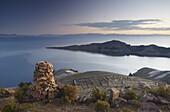 Stack of prayer stones on Isla del Sol (Island of the Sun), Lake Titicaca, Bolivia, South America