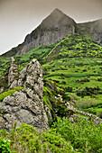 Volcanic basalt mountain Rocha dos Bordoes in the foggy highlands, Island of Flores, Azores, Portugal, Europe, Atlantic Ocean