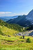 Several persons hiking descending from Schachen, Schachen, Wetterstein range, Werdenfelser Land, Upper Bavaria, Bavaria, Germany