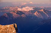 Schneefernerkopf in morning light and Lechtal Alps and Verwall range in background, from Zugspitze, Wetterstein range, Upper Bavaria, Bavaria, Germany