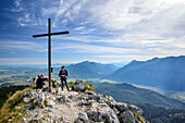Two persons hiking at Ettaler Manndl, Ester range in background, Ettaler Manndl, Ammergauer Alps, Upper Bavaria, Bavaria, Germany