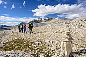 Several persons hiking on Pala plateau, Pala range, Dolomites, UNESCO World Heritage Dolomites, Trentino, Italy