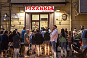 queue of customers waiting outside Pizzeria da Michele, Pizza, traditional, wood oven, popular, fast-food, Italian, restaurant, lifestyle, culture, Italian food, Naples, Italy