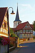 Church and half-timbered house at Ebertshausen, Community of Üchtelhausen, Unterfranken, Bavaria, Germany, Europe