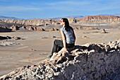 Young woman views to mountains and rock formations, Valle de la Luna, Valley of the moon, Atacama desert, National Reserve, Reserva Nacional Los Flamencos, Region de Antofagasta, Andes, Chile, South America