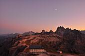 hut Rifugio Auronzo and peaks of Cadini di Misurina after sunset with moon, Val Pusteria Valley, Sesto, Dolomites, South Tyrol, Veneto, Alto Adige, Three Peaks (Tre Cime di Lavaredo) Nature Park, UNESCO world heritage side, Italy, European Alps, Europe