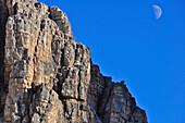 moonrise and half moon over  Three Peaks (Drei Zinnen), Val Pusteria Valley, Sesto, Dolomites, South Tyrol, Veneto, Alto Adige, Three Peaks (Tre Cime di Lavaredo) Nature Park, UNESCO world heritage side, Italy, European Alps, Europe
