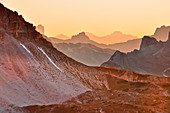Glowing mountains and sunset over mountain ranges from Three Peaks (Drei Zinnen), Val Pusteria Valley, Sesto, Dolomites, South Tyrol, Belluno, Veneto, Alto Adige, Three Peaks (Tre Cime di Lavaredo) Nature Park, UNESCO world heritage side, Italy, European