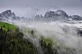 morning fog an and snow at mountain range Rosengarten, Catinaccio, St. Zyprian, Tiers, Tiers Valley, Nature Park Schlern-Rosengarten, Dolomites, South Tyrol, Alto Adige, UNESCO world heritage side, Italy, European Alps, Europe