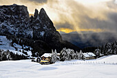 Snow and mystic light at early winter at Seiser Alm with Santnerspitze und Schlern with Rosszähnen, Seiser Alm, Alpe di Siusi, Sciliar, Nature Park Schlern-Rosengarten, Dolomites, South Tyrol, Alto Adige, UNESCO world heritage side, Italy, European Alps,
