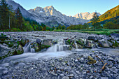 small waterfall and cascade of river Rißbach in front of Laliderer Wände, autumn, Engalm, Großer Ahornboden, Hinterriß, Engtal valley, Northern limestone alps, Karwendel Mountains, Tyrol, Austria, European Alps, Europe