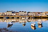 View across Rio Gilao towards fishing quarter, Tavira, Algarve, Portugal
