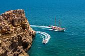Boats at Ponta de Piedade, Rocky coastline, Lagos, Algarve, Portugal