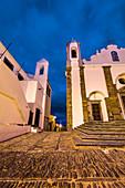 Old town at twilight with illuminated church, Monsaraz, Alentejo, Portugal