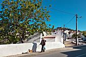 Man walking his dog near the castle, Evoramonte, Alentejo, Portugal