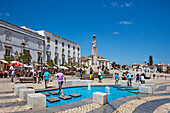 Children playing at the fountain, Praca da Republica, Tavira, Algarve, Portugal