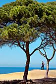 Hiker looking towards Praia de Falesia, Albufeira, Algarve, Portugal