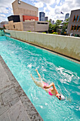 Sabina Allemann enjoys a few laps of swimming in a Southbank, Brisbane pool on the morning of August 30 2008. The riverside area of Southbank is a busy tourism and education precinct in this vibrant subtropical  city, the capital of the state of Queenslan