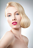 Caucasian woman with glamorous hairstyle and makeup