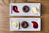 Platters of chocolate souffle dessert with ice cream and sauce