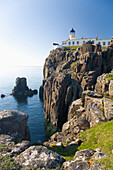 View to the clifftop lighthouse at Neist Point, near Glendale, Isle of Skye, Inner Hebrides, Highland, Scotland, United Kingdom, Europe